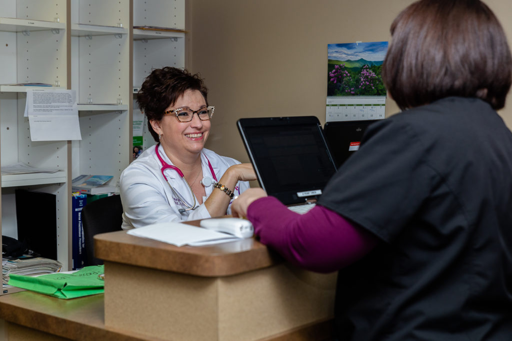 Nurse practitioner talking to nurse