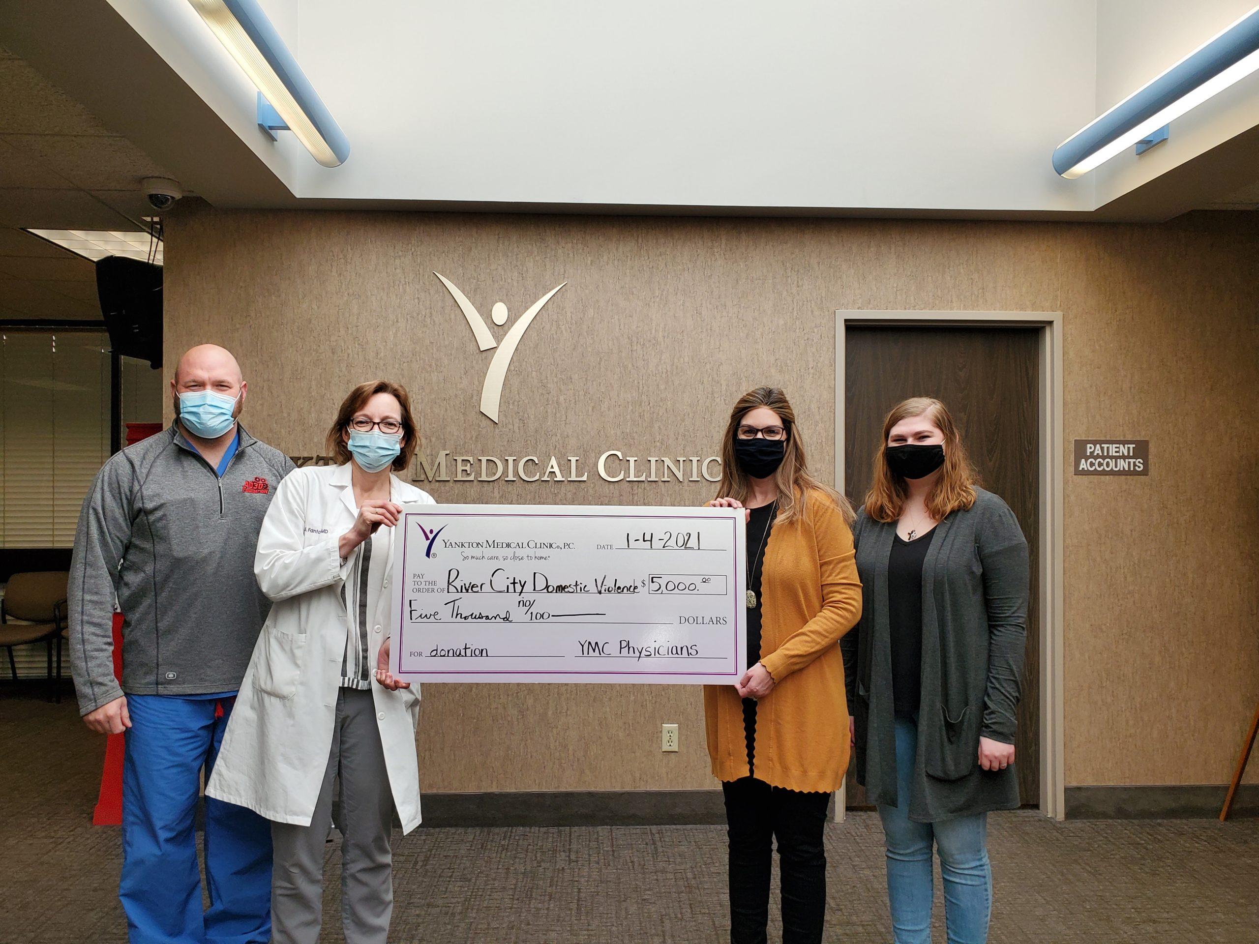 Yankton Medical Clinic Makes Donation to Domestic Violence Center
