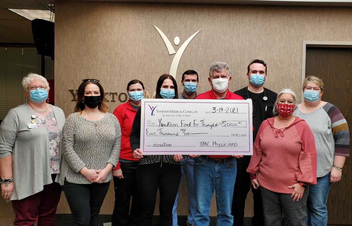 Yankton Medical Clinic physicians present a check to Food For Thought Board members for $5,000